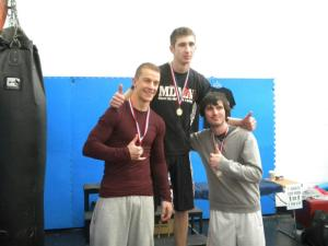 Tom McDonald winning a medal at a recent grappling tournament.